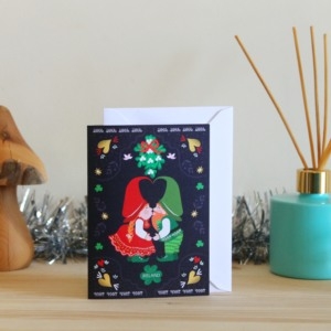 Christmas card kissing Irish gnomes